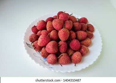 A plate of lychees, leechi, lichi, litchi on white background