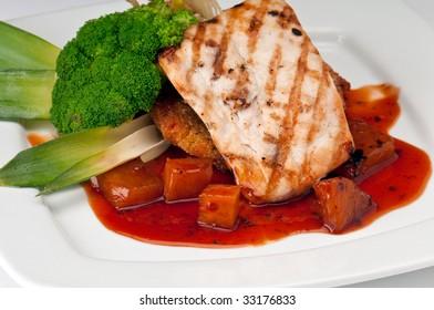Plate of Mahi Mahi, severd with vegetables, pineapple and soy sauce.