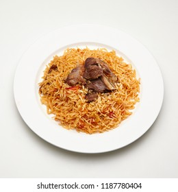 A plate of meat and rice kabsa