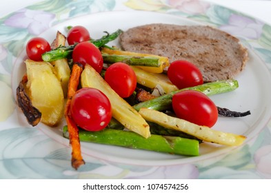 a plate with meat and vegetables