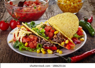 Plate of Mexican food Tacos on old wooden table