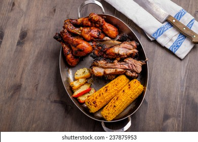 Plate with mixed bbq pork chicken corn
