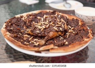 A plate of musakhan at a cafe in Dubai, United Arab Emirates. Musakhan is a Palestinian dish made with flatbread, chicken, onions, sumac and nuts.