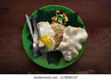 Plate of Nasi Goreng Ayam, traditional Indonesian food with chicken, vegetables, rice and scrambled egg
