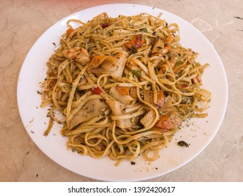 plate of noodles with prawns