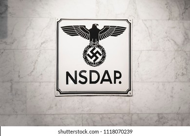 Plate of The NSDAP in a wall. It was the foreign organization branch of the National Socialist German Workers Party (NSDAP). Nazi Swastika