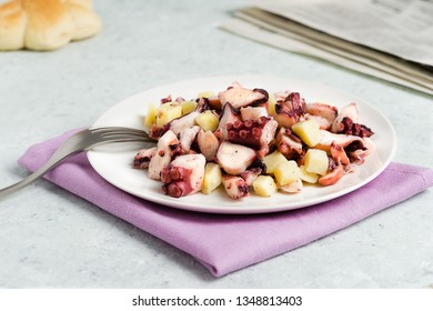 Plate of octopus salad with potatoes.