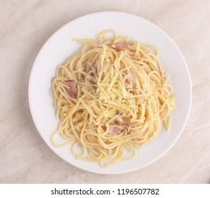 plate with pasta carbanara top view