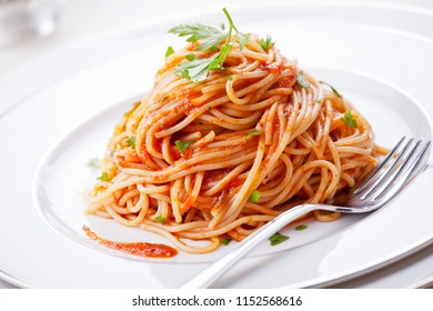 Plate of pasta with homemade tomato sauce and parsley