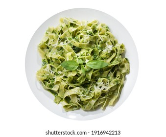 plate of pasta with pesto sauce isolated on a white background, top view