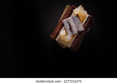 A plate of pastries against a dark background