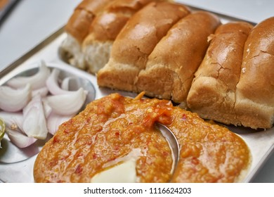 A plate of Pav Bhaji, a typical Indian stack consisting of bread and a form of lentil sauce.