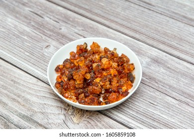 a plate of peach gum on the table