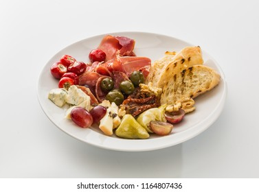 plate with peppers, bacon berries and cheese isolated on white background.