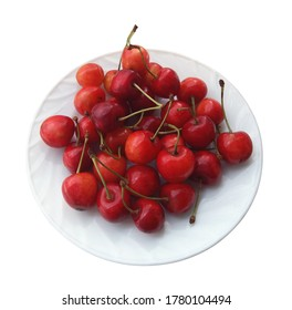 Plate with pink cherries, close up, isolation on white. Smart phone photo.