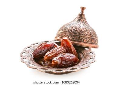 Plate of pitted dates isolated on a white background.