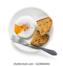 Plate of poached egg and bread isolated on white background, top view