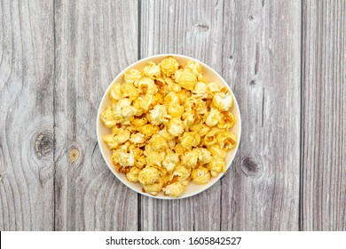a plate of popcorn on the table