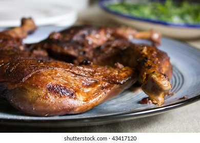 A plate of roasted duck legs