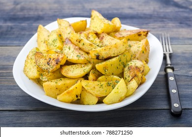 Plate with roasted potatoes cut into quarters