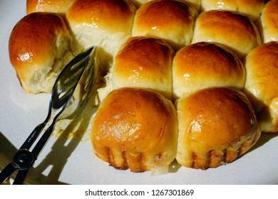 Plate of round German Buchteln filled brioche buns
