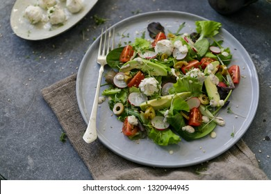 Plate with salad and goat cheese balls