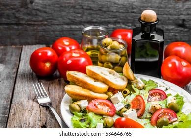 Plate of salad, greek food, mediterranean diet with vegetables and feta