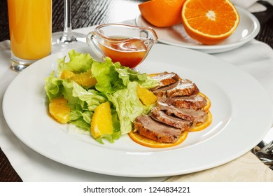 Plate of salad with meat and orange