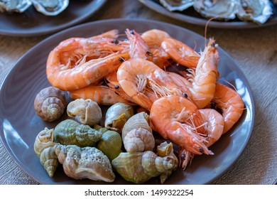 plate of seafood (oysters, shrimps and whelks)