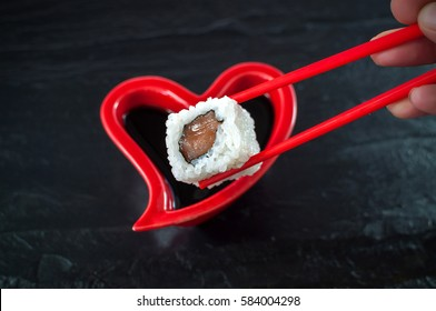 Plate in the shape of a heart and a piece of sushi