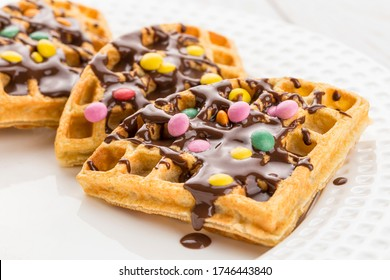 Plate of sliced ​​chocolate waffles and smarties