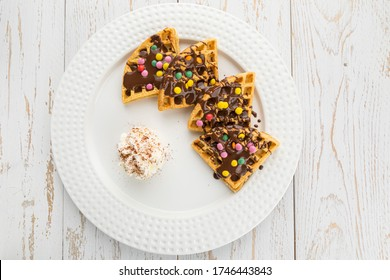 Plate of sliced chocolate waffles and smarties