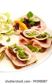 a plate of smoerrebroed or danish open sandwiches