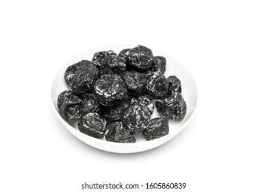 a plate of smoked plum on table