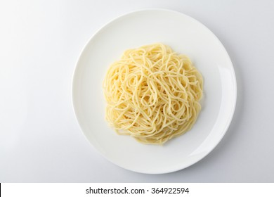 A plate of spaghetti pasta isolated on white background.