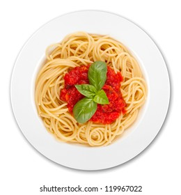 plate with spaghetti, sauce and basil on white background