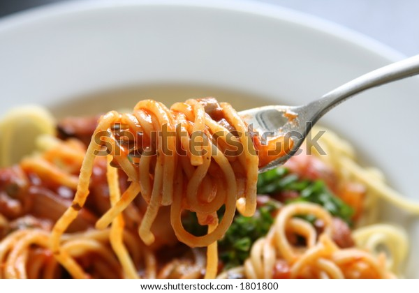 Plate of spaghetti with tomato sauce.