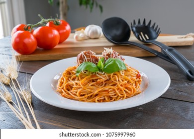 Plate of Spaghetti with tomato sauce, meatballs and Basil
