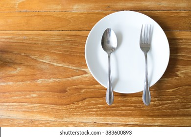 plate, spoon and fork