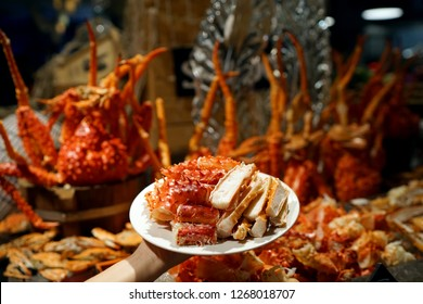 A plate of steamed Alaska king crab (Snow crab) legs, Dinner buffet seafood night.