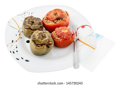 A plate with stuffed tomatoes and stuffed green peppers.Isolated (Greek cuisine)