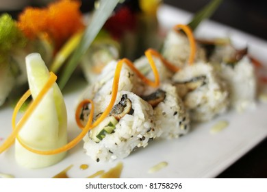 Plate of sushi with garnish.