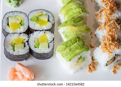 a plate with sushi mix with wasabi.