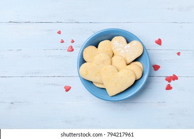 Plate with sweet baking for Valentines day. Shortbread cookies in shape of heart top view.