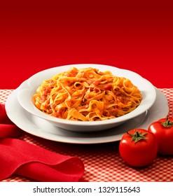 plate of tagliatelle, italian pasta, with tomato sauce