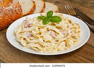 Plate of tagliatelli carbonara italian food in a rustic restaurant setting