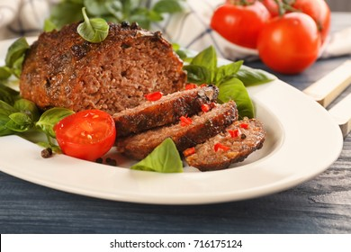 Plate with tasty baked turkey meatloaf on table