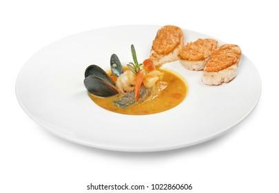 Plate of tasty bouillabaisse on white background