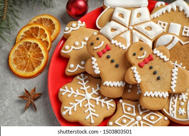 Plate with tasty homemade Christmas cookies on grey table, closeup