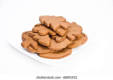 Plate of tasty homemade gingerbread cookies on isolating background